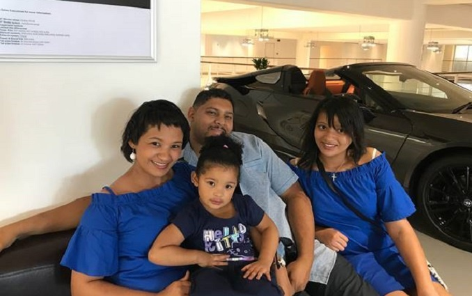 Caeana (left) and Michael with their daughters, Ho