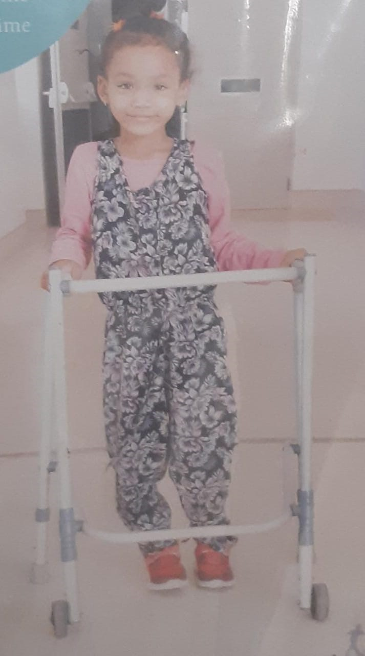 Ashline when she started walking assisted by a wal