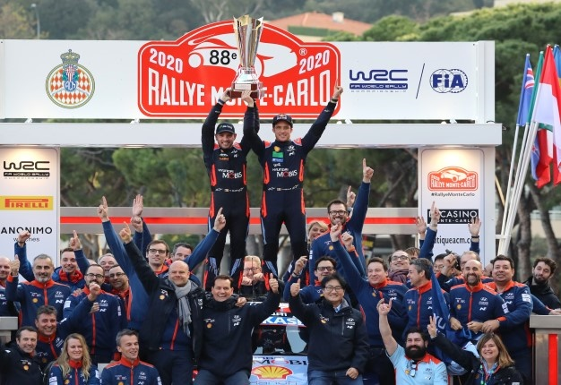 Toyota Hyundai i 20 WRC Belgium's driver Thierry Neuville (R) and his co-pilot Nicolas Gilsoul (L) celebrates on podium after the 88th Monte-Carlo Rally. Valery HACHE / AFP