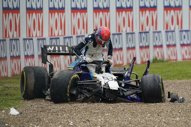 Formula One World Championship, Emilia-Romagna Grand Prix, race. George Russell from Great Britain of Team Williams Racing gets out of his race car after the accident with Merceds driver Bottas.