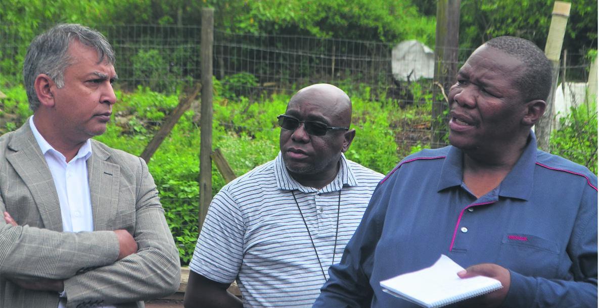 Deputy mayor Manilal Inderjit, senior finance manager Sipho Nxumalo (centre) and Mayor Mzimkhulu Thebolla at Peacevalley 3 on Friday.PHOTO: NOKUTHULA NTULI