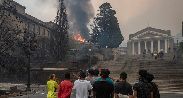 Students watch as a building at University of Cape Town.
