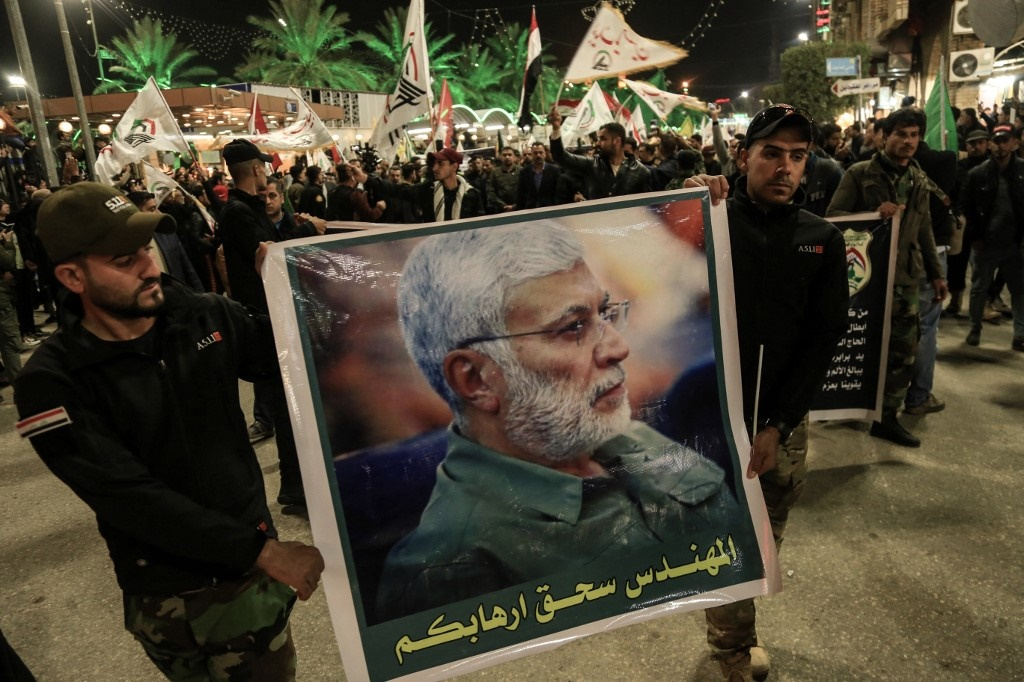 Mourners gather during the funeral procession of slain Iraqi paramilitary chief Abu Mahdi al-Muhandis (image), Iranian military commander Qasem Soleimani and eight others in the Iraqi central city of Karbala on January 4, 2020.
