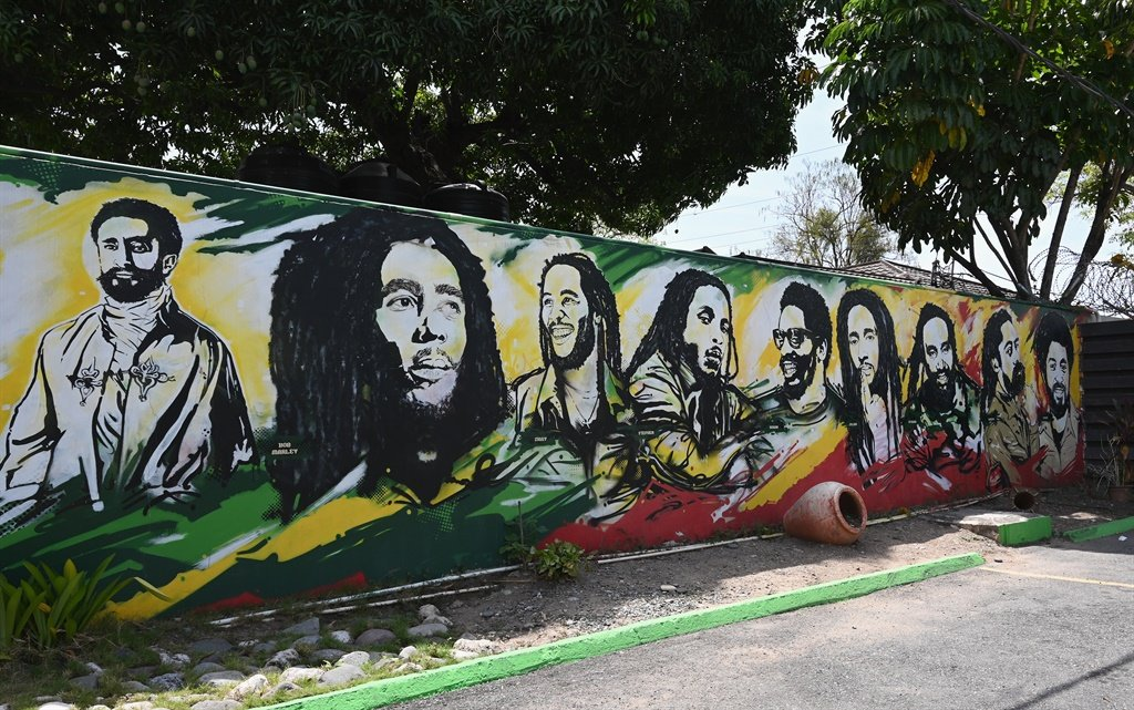 A mural depicting Ethiopian Emperor Haile Selassie I, Jamaican Reggae legend Bob Marley and his seven sons is seen on the grounds of the Bob Marley Museum in Kingston, Jamaica. (Angela Weiss / AFP)