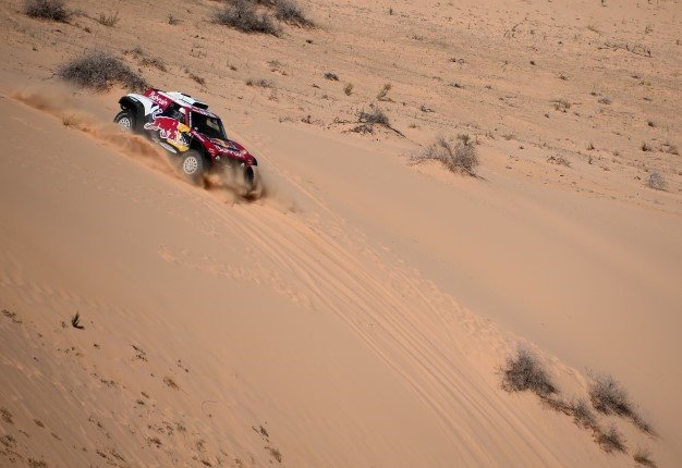Mini's Spanish drivers Carlos Sainz of Spain and co-driver Lucas Cruz of Spain compete during the Stage 5 of the Dakar 2020 between Al Ula and Ha'il on January 9, 2020. FRANCK FIFE / AFP