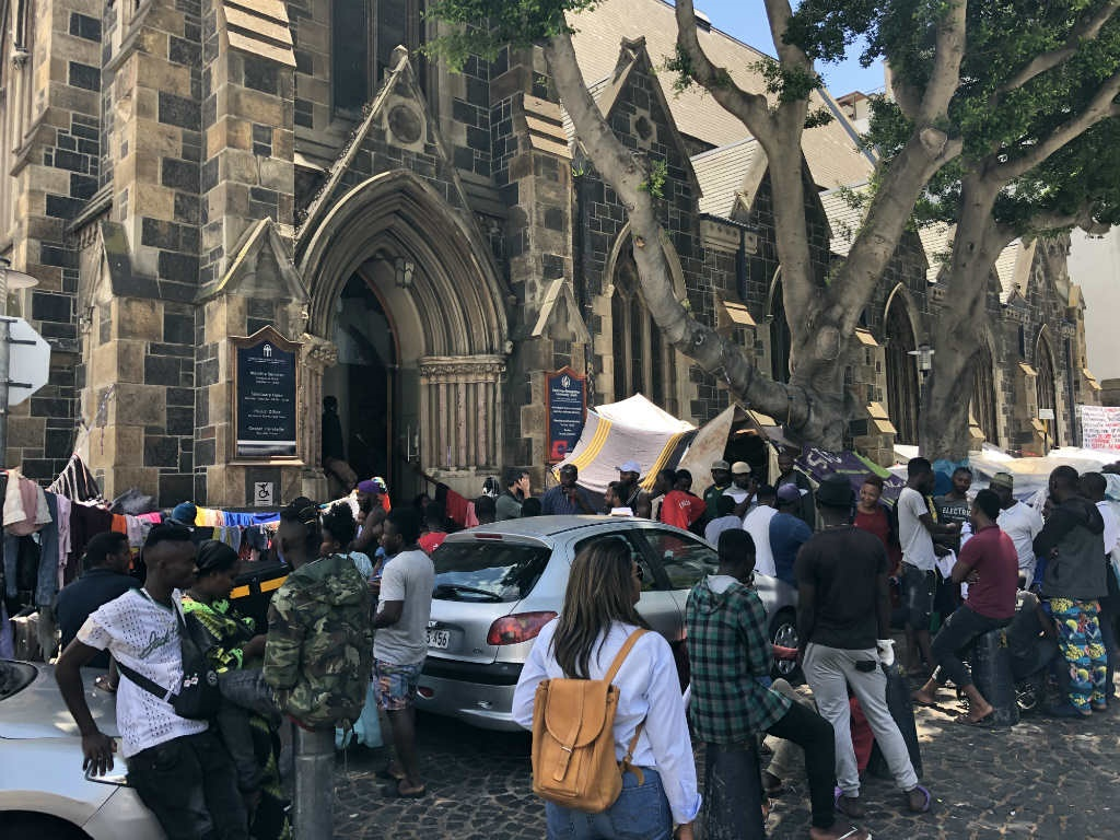 The City of Cape Town will soon begin 'enforcement operations' against a group of refugees camping outside the Central Methodist Church in Greenmarket Square. (Lucas Nowicki, GroundUp)