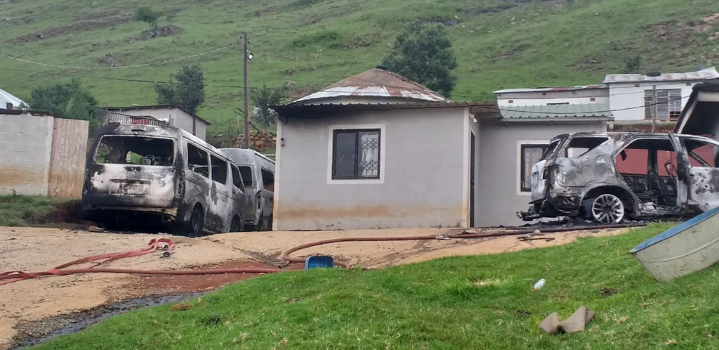 The suspects went to the victims' house and set alight two minibus taxis and two more vehicles. (Supplied)