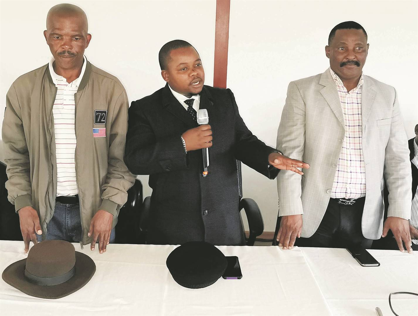 AbaThembu acting King Azenathi Dalindyebo flanked by senior traditional Nkosi Dumisani Mgudlwa (left) and his uncle Prince Mankunku Dalindyebo (right) at Bummbane Great Place following a meeting of abaThembu Picture: Lubabalo Ngcukana