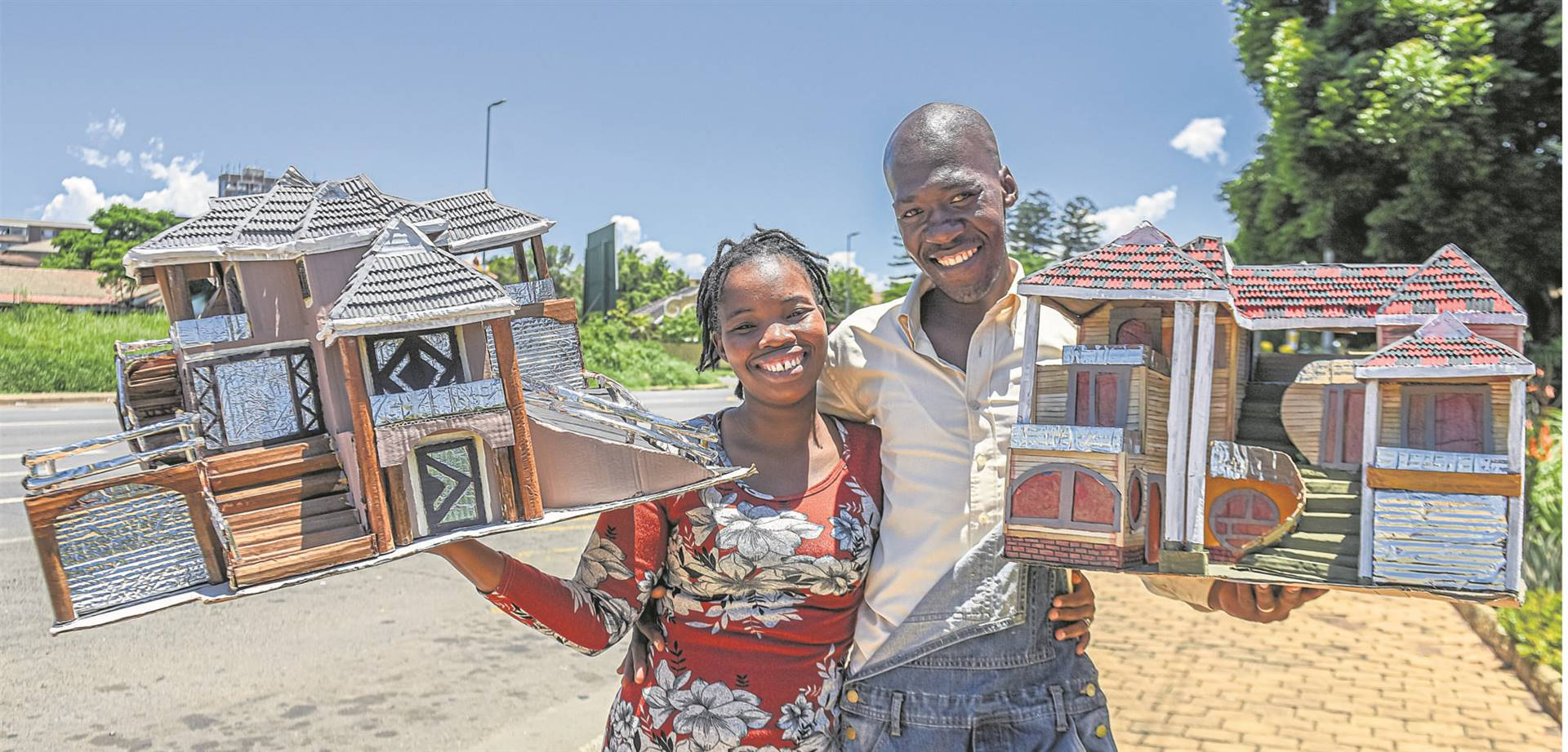 Mondli Mkhize and his wife Ayanda hold some of their model houses made from recycled rubbish.PHOTO: Moeketsi Mamane