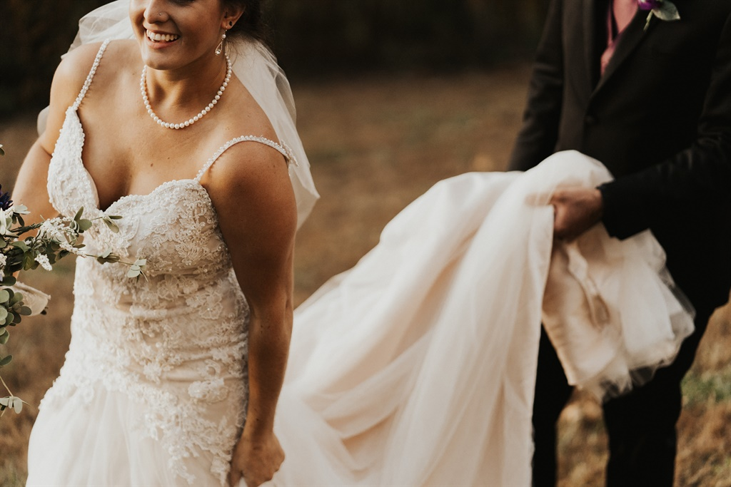 bride pays with exposure