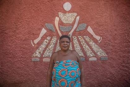 A Vodoun priestess poses for a portrait at a Vodou