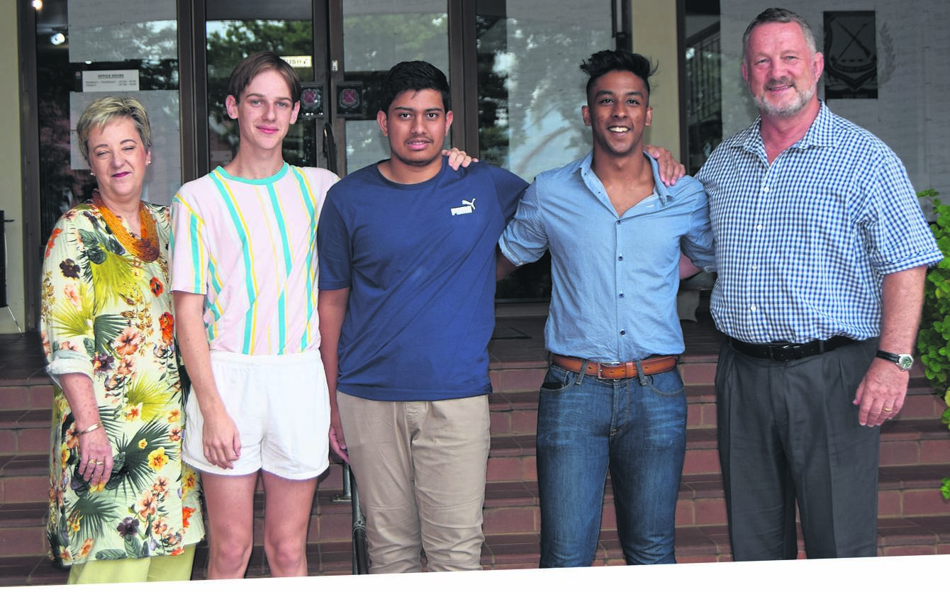 The Maritzburg College staff congratulate their top three matric 2019 achievers. Seen (from left) is Jeanette Finnie [deputy head of academics] with matrics James McFarland, Muhammad Essack and Hemal Heerelal with Chris Luman [headmaster].PHOTO: SUPPLIED