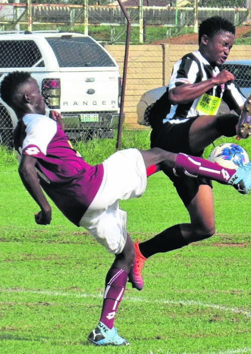 D'General FC Tshepo Motlomelo (black) tussles for the ball with Mangaung Unite's Phemelo Phokontsi during their teams ABC Motsepe League first round fixture played at Clive Solomon Stadium last Saturday. Mangaung won 1-0. Photo: Teboho Setena