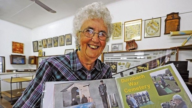 Pietermaritzburg resident Margaret Fitzroy holds up the scrapbook she compiled detailing her uncle's burial, 72 years after he died when his plane was shot down by German soldiers in 1943.
