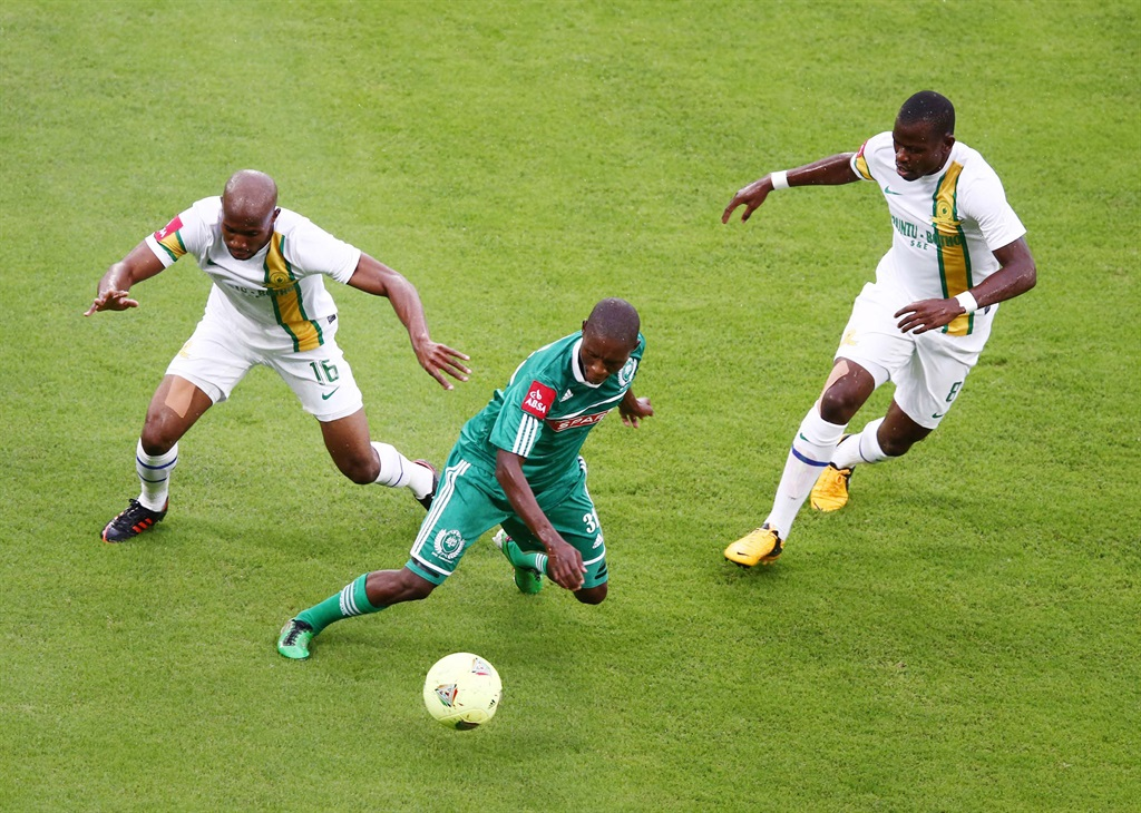 Njabulo Manqana of AmaZulu beats Ramahlwe Mpahlelel of Mamelodi Sundowns to the ball during the Absa Premiership match in 2013. Picture: Anesh Debiky/Gallo Images