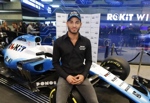 Israeli driver Roy Nissany poses next to his car in the Israeli coastal city of Tel Aviv on January 15, 2020 after signing with the British Formula 1 Williams team.