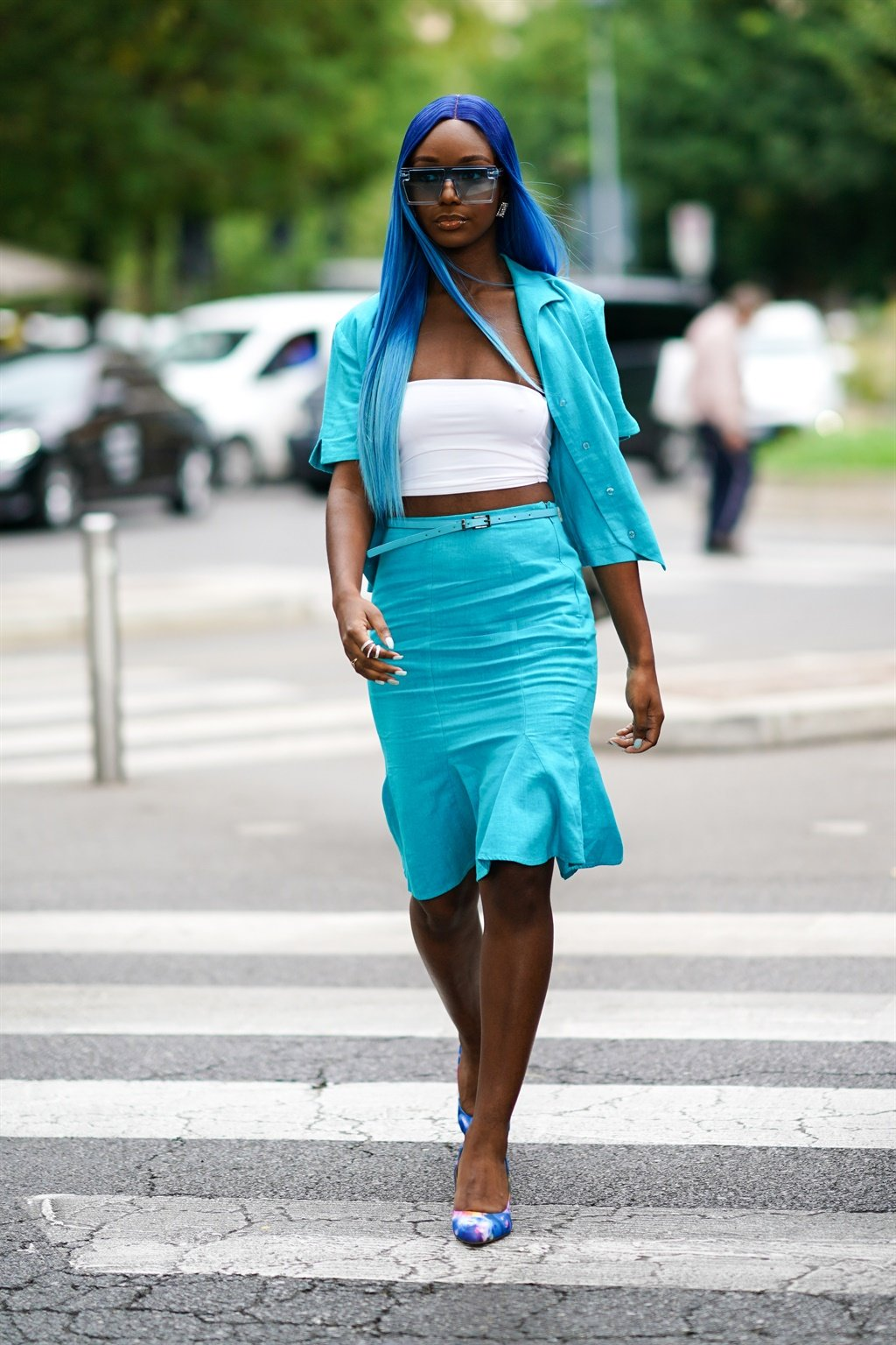 MILAN, ITALY - SEPTEMBER 19: A guest wears blue su