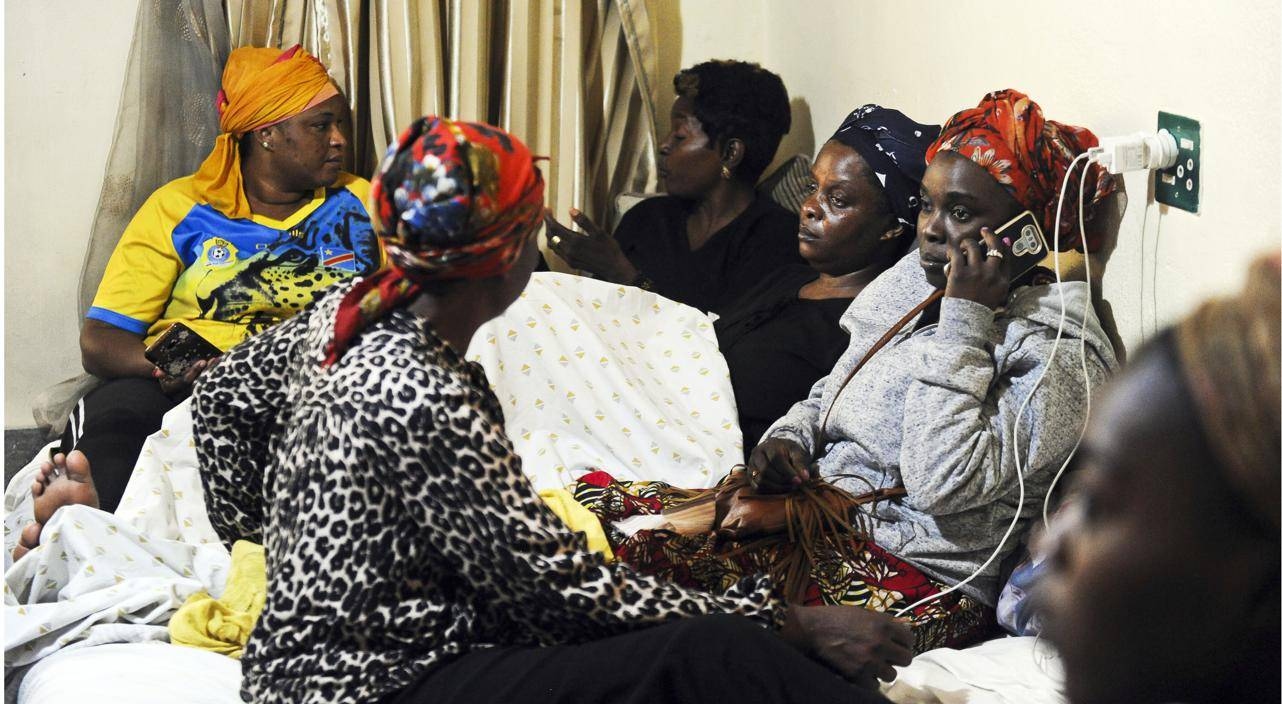 Enock Mpianzi's mother Anto Mpianzi, seated on a mattress, is comforted by family members as she mourns her son at their home in Malvern, Johannesburg. Parktown Boy's pupil Enock Mpianzi's body was found in the Crocodile River near the Nyati Bush and Riverbreak where the boy was attending the school's orientation camp in Brits, North West. Picture: Rosetta Msimango