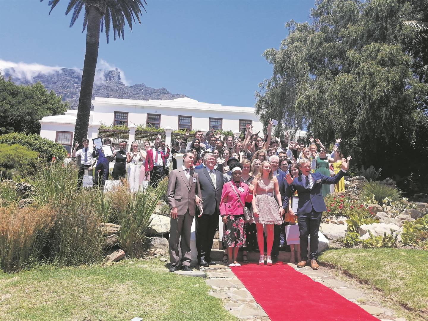 The Western Cape's top achievers in the 2019 National Senior Certificate Examinations on the steps with dignitaries on the steps in front of Leeuwenhof. PHOTO: Nettalie Viljoen
