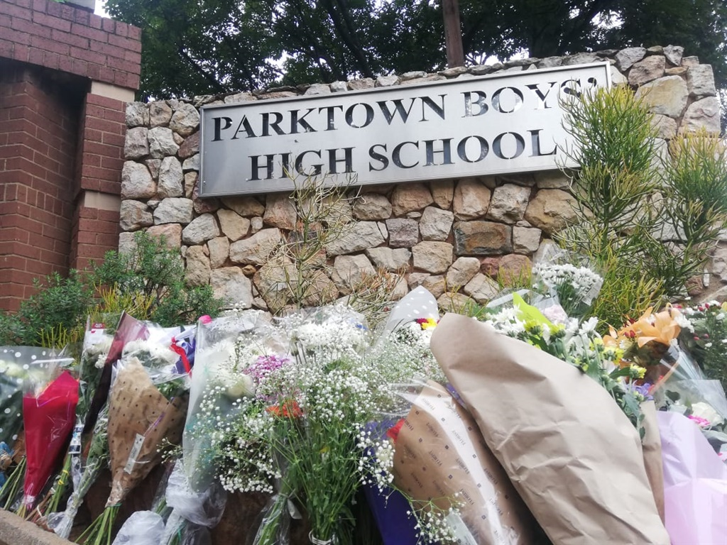 Flowers laid in front of Parktown Boy's High in honour of Enoch