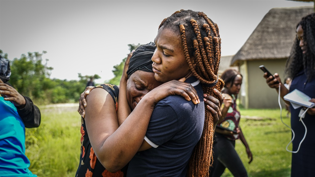 Anto Mpianzi is comforted by family members during a site inspection at the Nyati Bush and River Break lodge near Brits in North West where her son's body was found. (Chanté Schatz, News24)