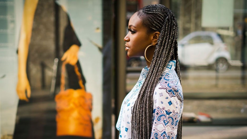 A guest with trendy braids attends the Milan Fashion Week (Photo by Nataliya Petrova/NurPhoto via Getty Images)