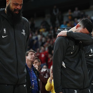 Players of the Houston Rockets mourn the death of