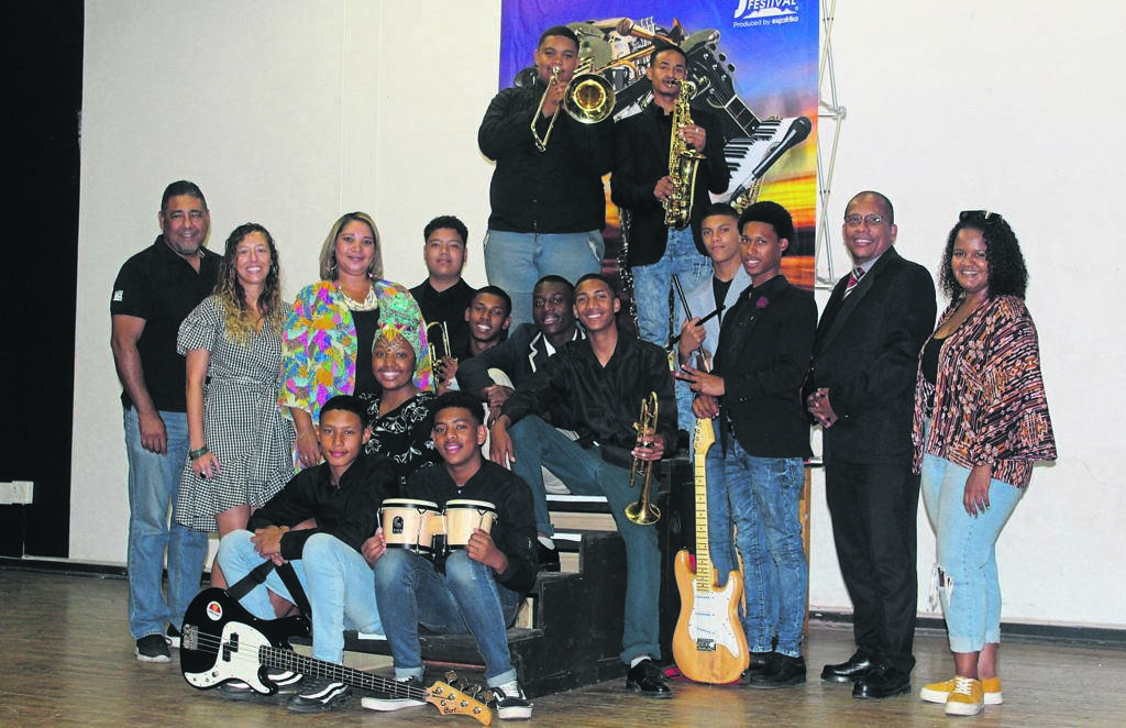 The Wynberg Secondary School band with ESP Africa's Craig Parks (middle row, far left). Next to him stand Corinne Becker of ESP Africa with Celest Moses-Toefy, the music teacher at the school. ESP Africa facilitator Lana Crowster (middle row, far right) stands next to Gavin Niewoudt, the school's principal. PHOTO: Nettalie Viljoen