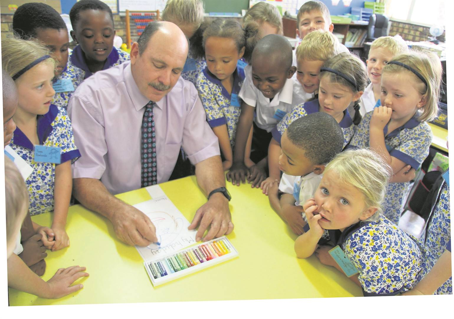 Laddsworth Primary School headmaster Gavin Lambooy drawing a picture about the school holidays with the new Grade One pupils. PHOTO: supplied