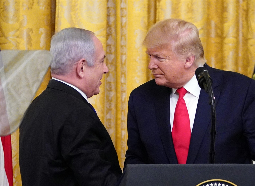 President Donald Trump and Israeli Prime Minister Benjamin Netanyahu take part in an announcement of Trump's Middle East peace plan in the East Room of the White House in Washington, DC. (AFP)