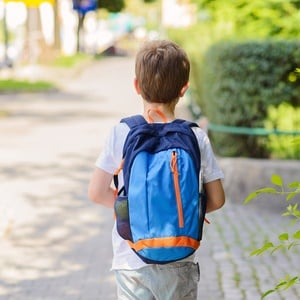 Boy with backpack at school