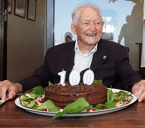 Mike Hoare sitting in front of a birthday cake. (Roy Reed, Family handout, AFP)
