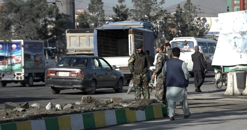Security forces inspect the area after a bomb-laden vehicle attack carried out against the Afghani security forces' convoy in Kabul, Afghanistan. (Photo by Sayed Khodaiberdi Sadat/Anadolu Agency via Getty Images)