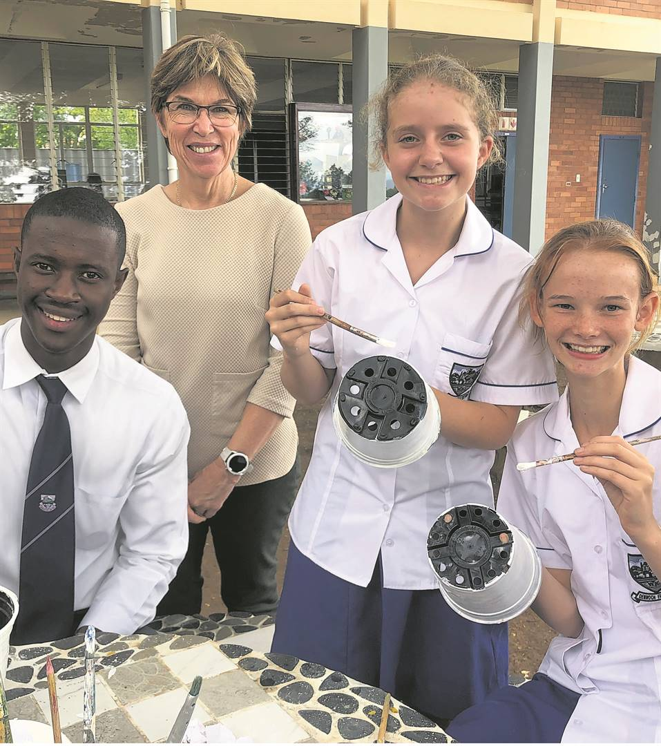 photo: SUPPLIED(From left) Langelihle Zondi, Mrs Calitz, Monique Walkinshaw and Rebecca Witthöft painting their garden pots.