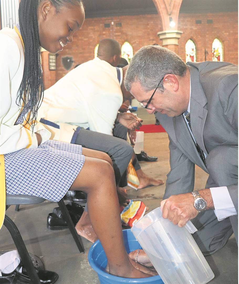 St Nicholas Diocesan School's Prefect induction consisted of a Holy Mass and Foot Washing Ceremony. The principal washed the prefect's feet and them in turn washed the feet of the Grade 8 pupils. At the ceremony, principal Leon Grové is seen washing the feet of head prefect Sthuthukile Conco. PHOTO: supplied