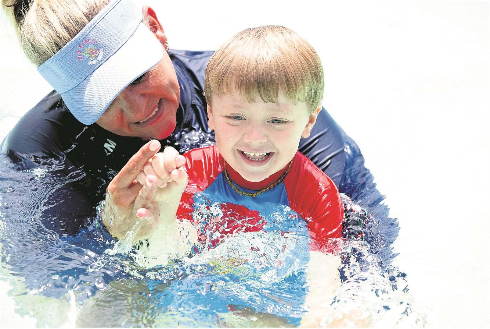 St Charles College has partnered with Seals Swimming Club to heat up their junior pool and has made available a qualified Learn to Swim coach. Pictured, coach Odette van der Merwe is building confident boys in the pool including Tyler Berry.PHOTO: SAYSHA BAKER