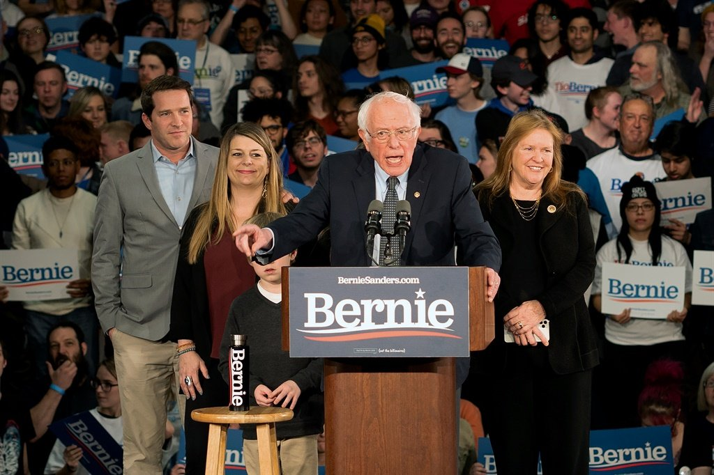 Democratic presidential candidate Vermont Senator Bernie Sanders speaks to supporters as they wait for results to come in at his caucus night watch party in Des Moines, Iowa (kerem yucel / AFP)
