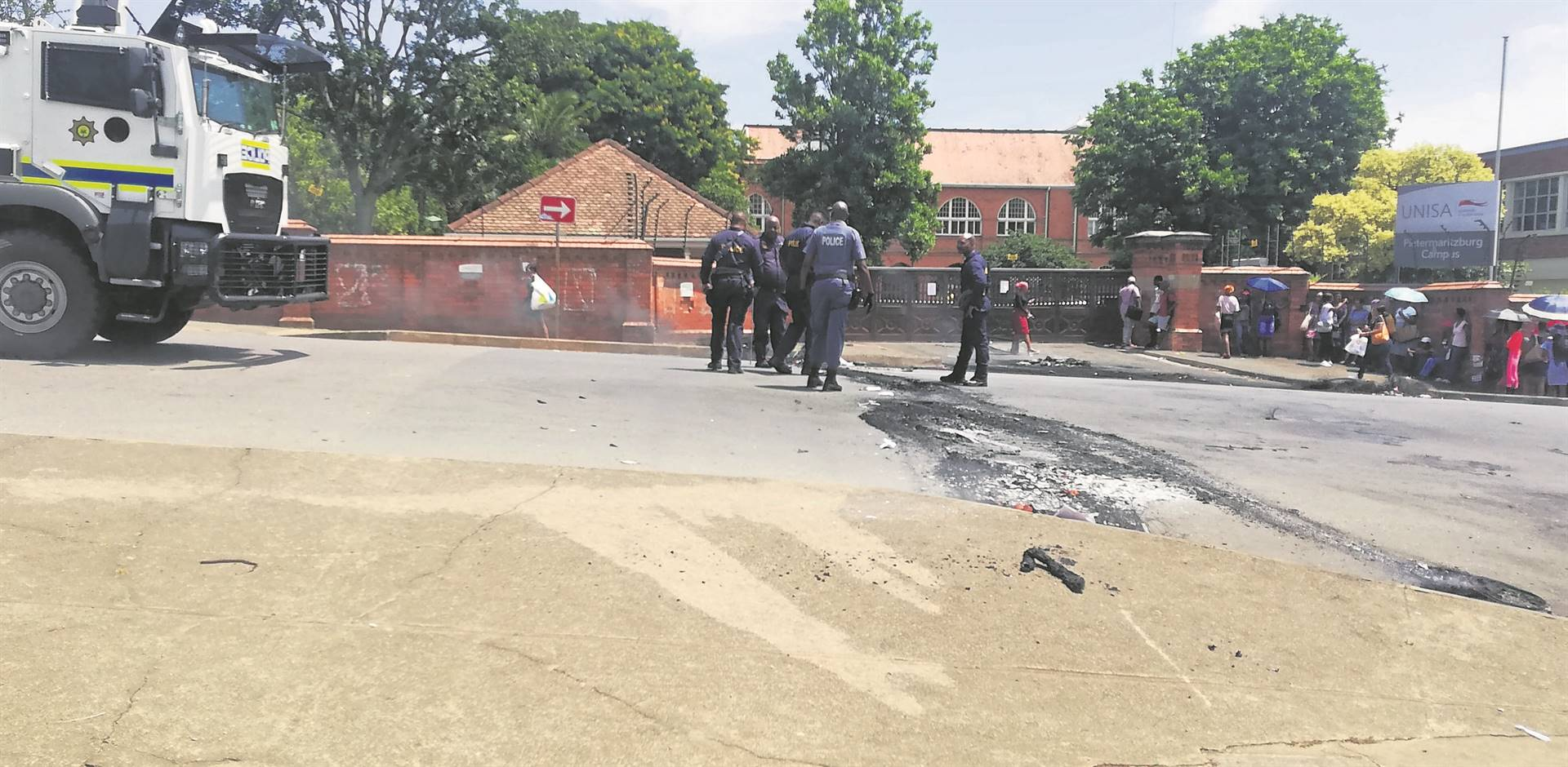 PHOTO: lethiwe makhanyaPublic Order Police try to open the road that was blocked by students with burning tyres on Monday.
