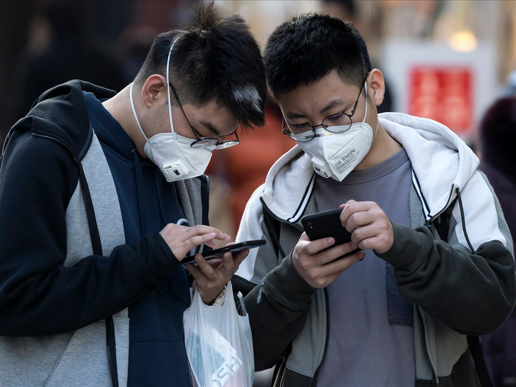 Chinese tourists wearing masks in the Ginza shopping district on January 24, 2020 in Tokyo, Japan.