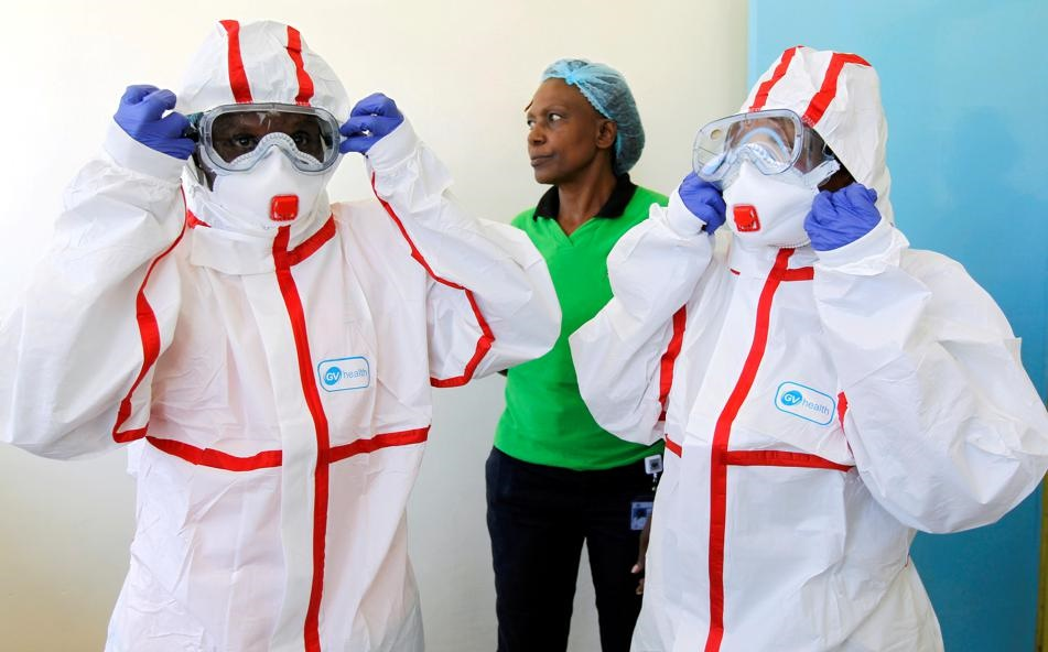 Kenyan nurses wear protective gear during a demonstration of preparations for any potential coronavirus cases at the Mbagathi Hospital, isolation centre for the disease, in Nairobi, Kenya. Picture: Njeri Mwangi/Reuters