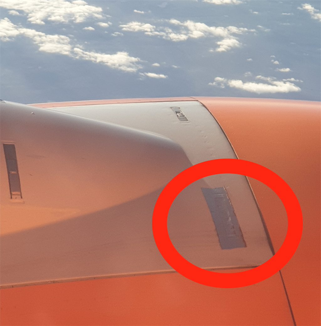 A Mango airplane wing spotted with the aviation ta