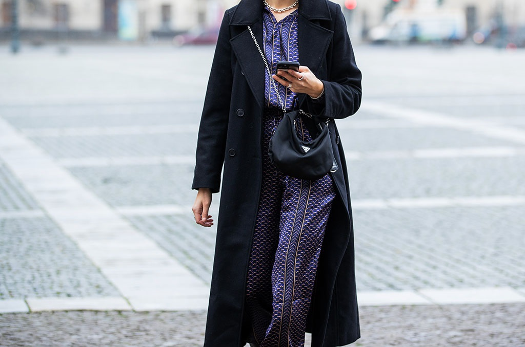 Jacqueline Zelwis is seen wearing Lala Berlin silk pants and top with print, Gestuz coat in black, Prada bag on in Berlin, Germany. (Photo by Christian Vierig/Getty Images)