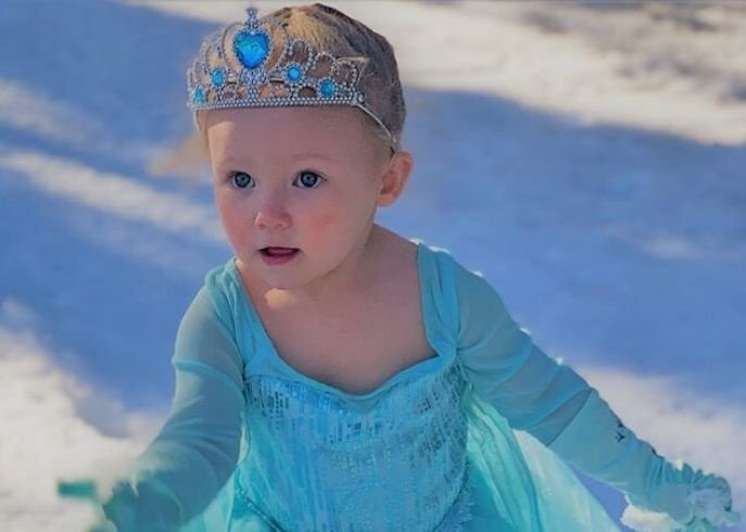 Madelyn, 2, getting her Elsa from Frozen on.