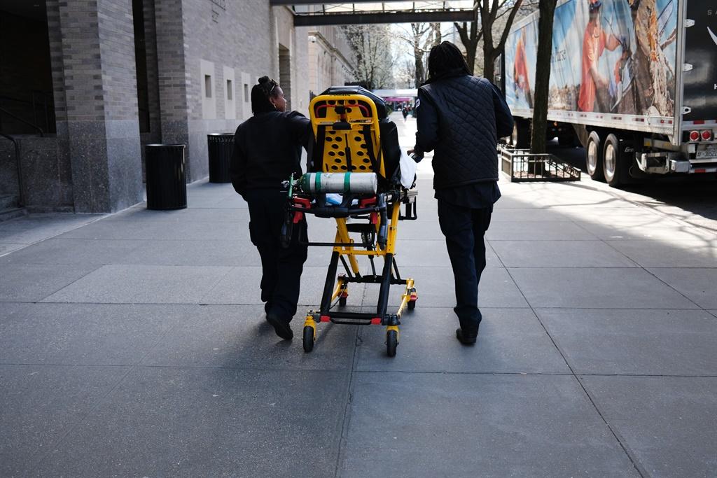 NEW YORK, NY â?? APRIL 01: Ambulance drivers walk