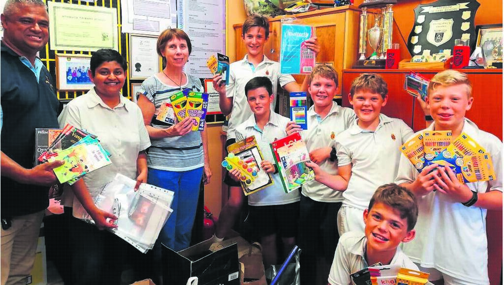 Delene Mark (second left) from the NGO Hope Africa with representatives from Bishops Preparatory School at the handing over of the stationery. With her are from left: Tyrone Adams, Sue Kieswetter, Sebastian Cudmore, Naethan Mol, Kai Bacher, Oliver Howie, Joshua Huntingford and Anthony Lampe.