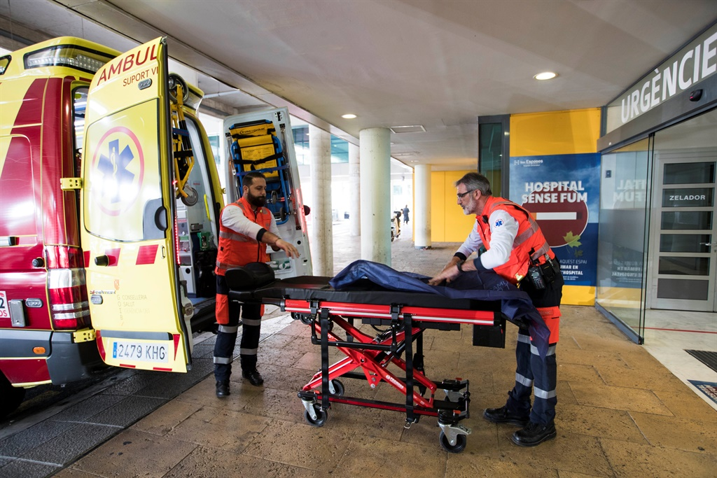 Two men ready an ambulance outside the Son Espases University Hospital in Palma de Mallorca where a British man has been diagnosed with coronavirus. (AFP)