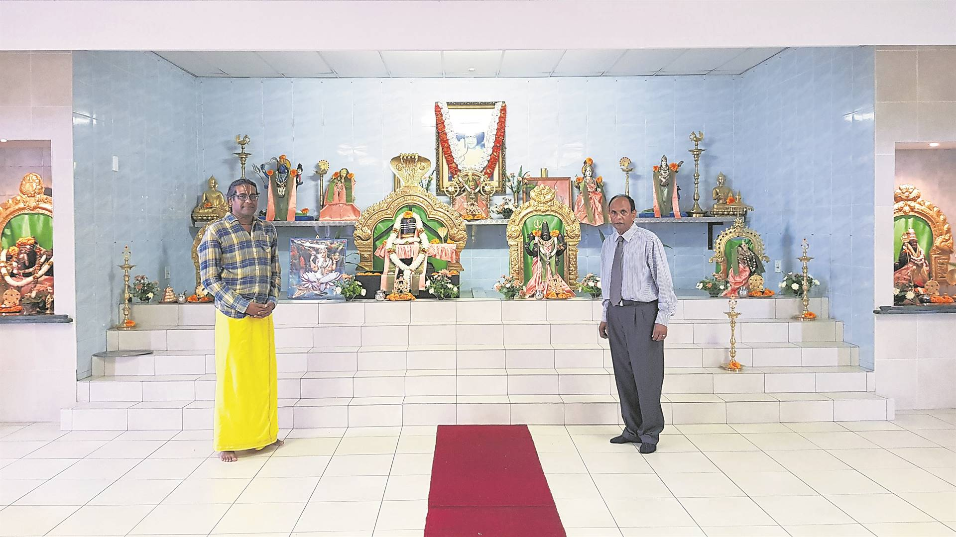 From left: Guru Bhavan and Victor Pillay inside the temple.PHOTO: byrone athman