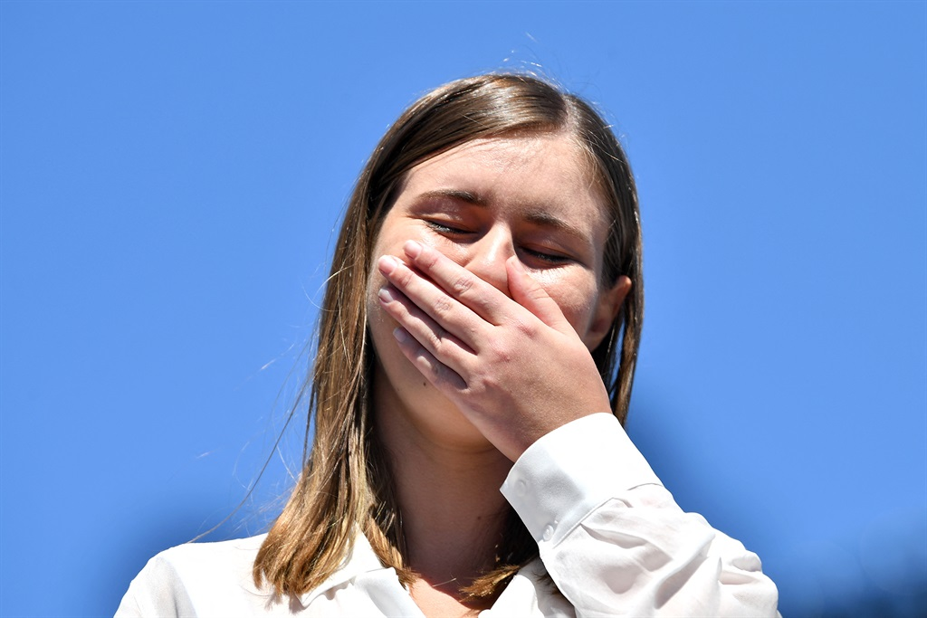 Former government staffer Brittany Higgins, who alleged publicly last month that she had been raped by a colleague in a minister's office in 2019, reacts as she speaks before protesters during a rally against sexual violence and gender inequality in front of Parliament House in Australia's capital city Canberra.