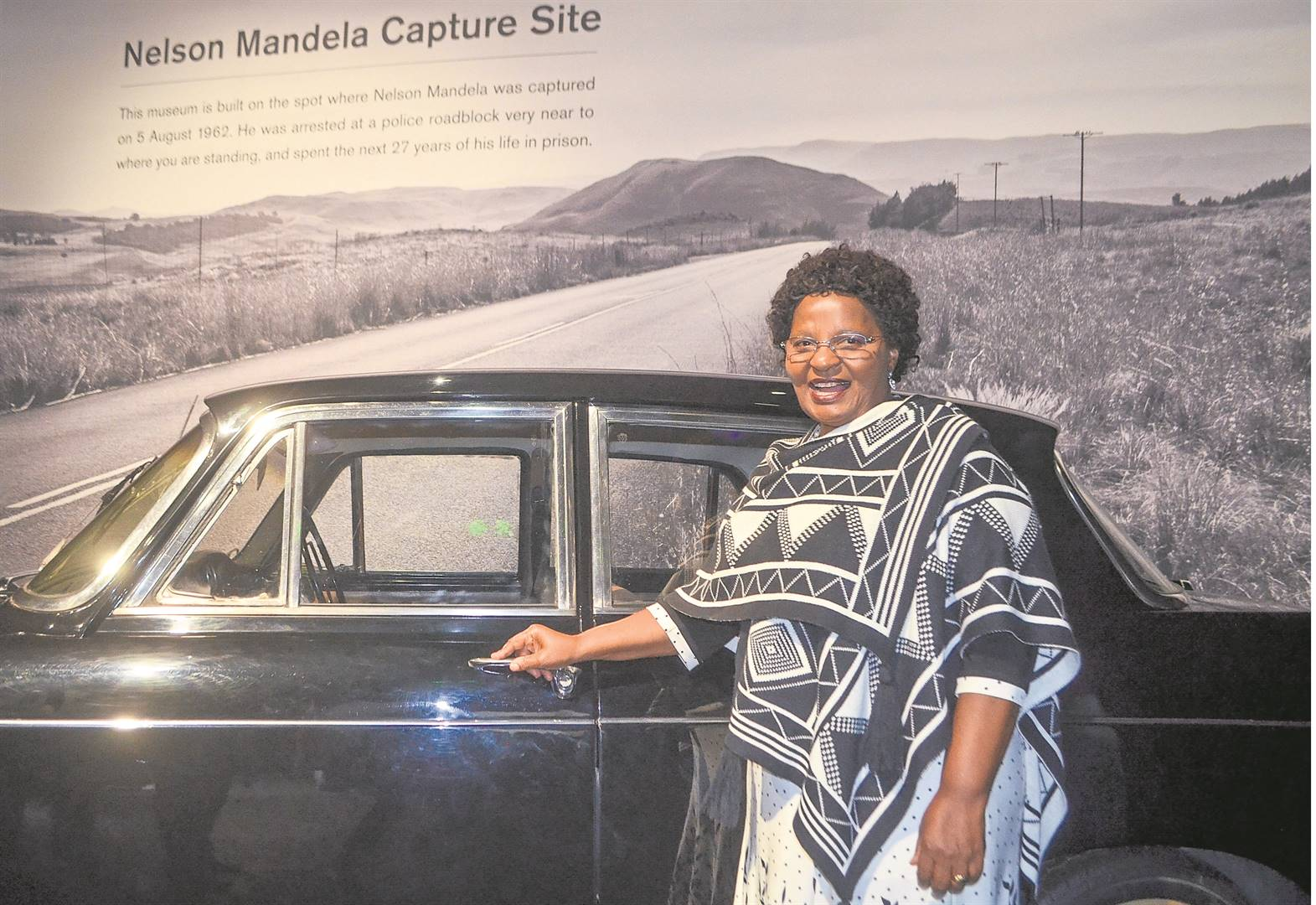 uMgungundlovu District Mayor Thobekile Maphumulo standing next to an Austin Westminster car like the one Nelson Mandela was travelling in when he was arrested in 1962. PHOTO: NOKUTHULA NTULI