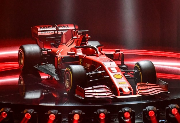This photo taken and handout by the Ferrari Press Office on February 11, 2020 shows the new Ferrari Formula 1 SF1000 during its unveiling ceremony at Teatro Romolo-Valli in Reggio Emilia. Handout / FERRARI PRESS OFFICE / AFP